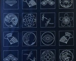 sashiko panel with crests fans and dragonflies