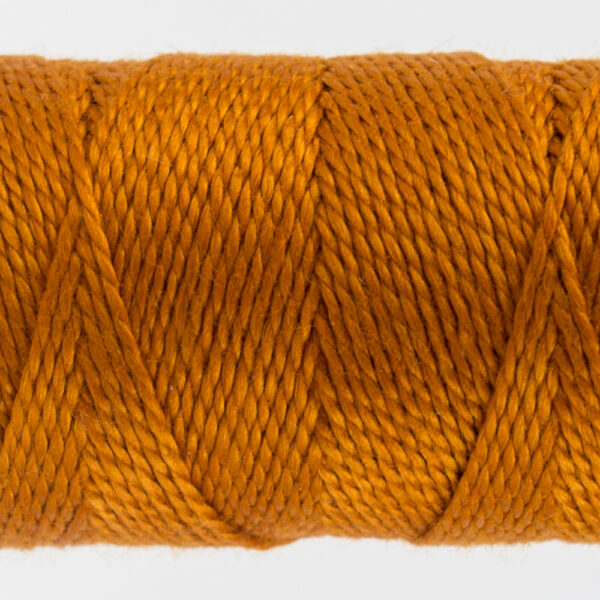 closeup of ochre perle cotton thread